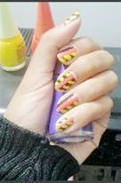 Orange Black and Yellow Nails