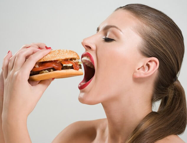 Woman Eating Fastfood